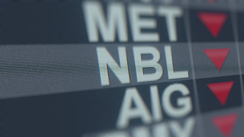 NOBLE ENERGY NBL stock ticker on the screen with decreasing arrow. Editorial GIF