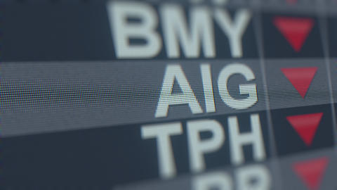 AMERICAN INTERNATIONAL GROUP AIG stock ticker with decreasing arrow. Editorial GIF