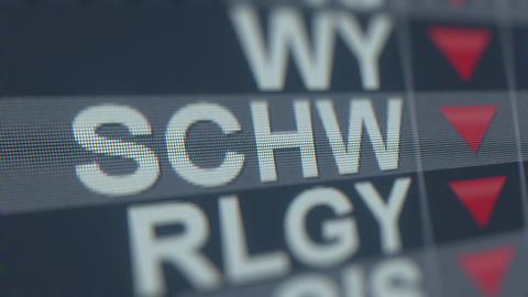 CHARLES SCHWAB SCHW stock ticker on the screen with decreasing arrow. Editorial GIF