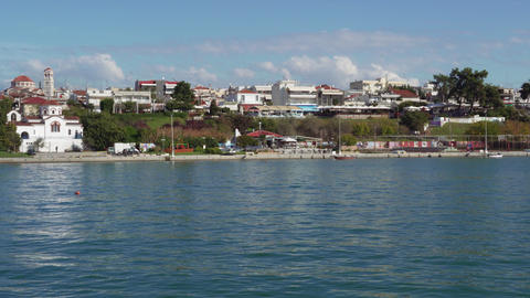 Greek coastal village with low-rise buildings and Orthodox churches Footage