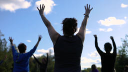 Women exercising raising arms Footage