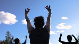 Women exercising lowering arms Footage