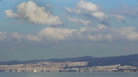 Thessaloniki, Greece landscape coastal view of east city area with clouds above GIF
