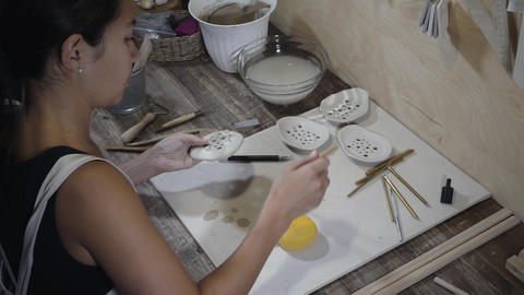 Woman works with earthenware in studio Footage