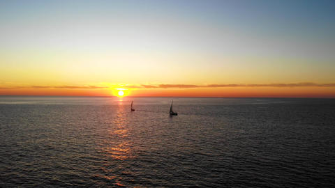 Two Yachts Sail in the Sea at Sunset Footage
