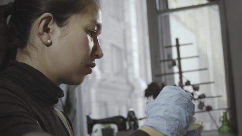 Asian woman glazes pottery in workshop Footage