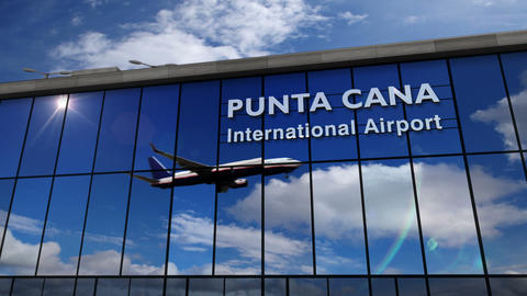 Airplane landing at Punta Cana mirrored in terminal Live Action