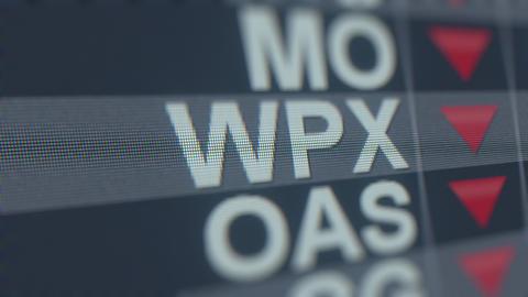 WPX ENERGY WPX stock ticker with decreasing arrow, conceptual Editorial crisis Footage