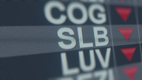SCHLUMBERGER SLB stock ticker on the screen with decreasing arrow. Editorial GIF