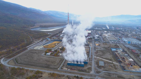 Aerial View of Metallurgical Plant Factory with Smoke Coming Out of Factory GIF