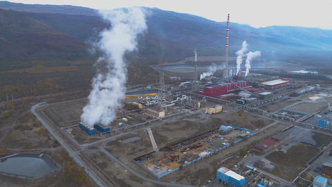 Aerial view of big copper smelter and refinery Factory with smoking pipes in GIF