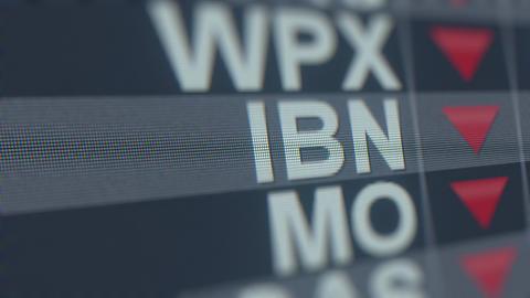 ICICI BANK ADR IBN stock ticker with decreasing arrow, conceptual Editorial Footage