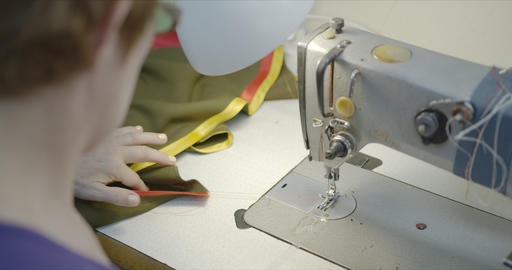 Woman seamstress working on an industrial sewing machine Footage
