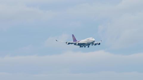 Thai Airways Boeing 747 approaching over ocean Footage