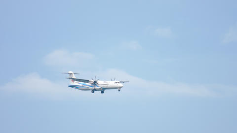 Turboprop aircraft approaching GIF