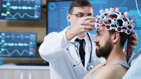 Patient prepared for brain scan in modern facility GIF
