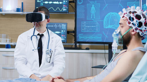 Doctor in a neuroscience centre wearing a virtual reality goggles ビデオ