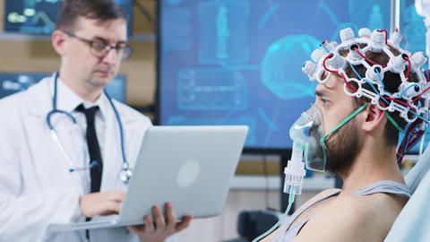 Doctor using his laptop in a modern facility for brain research GIF
