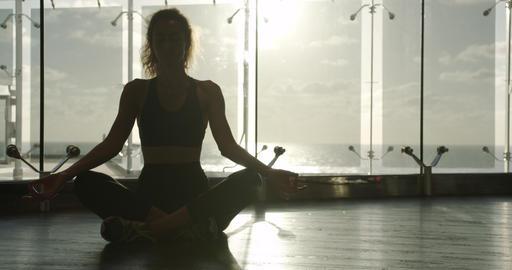 Young beautiful woman has meditating during training. Sporty girl doing yoga Archivo