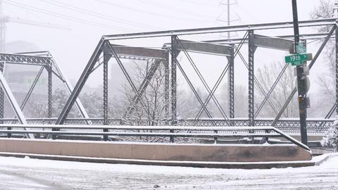 Bridge and Road in Snowstorm Pan GIF