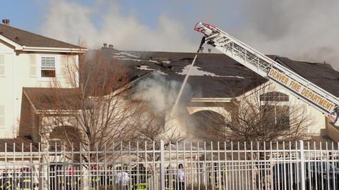Denver Fire Department Extinguishing Condo Fire GIF