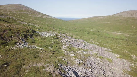 Fell side aerial shot with summer trekking routes at Pallas, Finnish Lapland Live Action