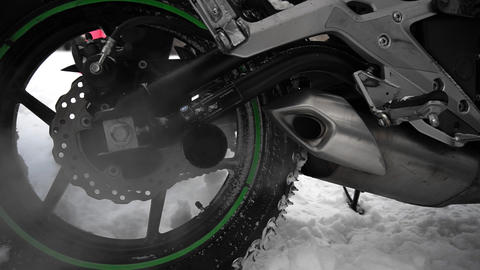Gas and steam from the motorcycle exhaust pipe in winter, closeup Live Action