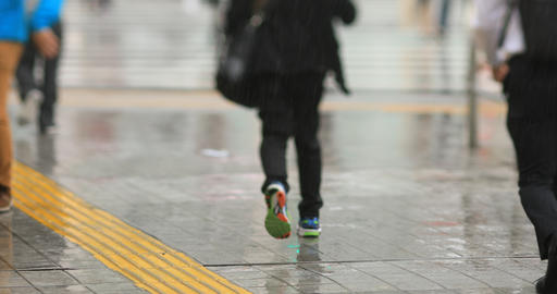 Walking people at the downtown street in Shinagawa Tokyo rainy day handheld GIF