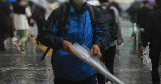 Walking people at the downtown street in Shinagawa Tokyo rainy day GIF