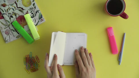 Top view overhead of woman writing her plan word FITNESS in diary ビデオ