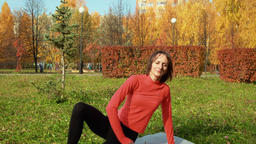 Fitness woman training exercise outdoor in autumn park in city. Sport coach GIF