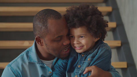 Cheerful mixed race son sharing secret with father Footage
