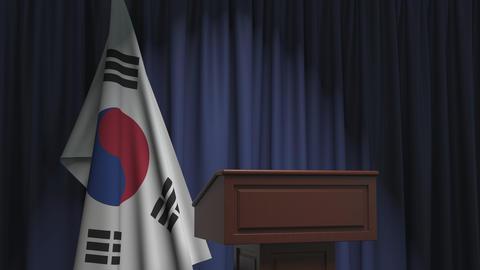 Flag of South Korea and speaker podium tribune. Political event or statement Live Action