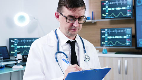 Doctor in neuroscience centre writing notes on clipboard GIF