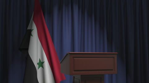 Flag of Syria and speaker podium tribune. Political event or statement related Live Action