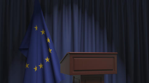 Flag of the European Union and speaker podium tribune. Political event or Live Action