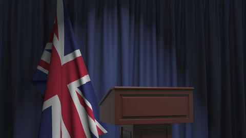 Flag of Great Britain and speaker podium tribune. Political event or statement Live Action