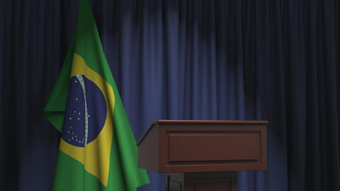 Flag of Brazil and speaker podium tribune. Political event or statement related Live Action
