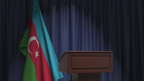 Flag of Azerbaijan and speaker podium tribune. Political event or statement Live Action