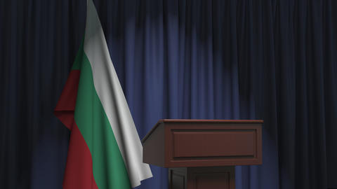 Flag of Bulgaria and speaker podium tribune. Political event or statement Live Action