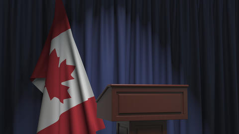 Flag of Canada and speaker podium tribune. Political event or statement related Live Action