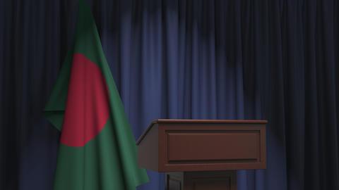 Flag of Bangladesh and speaker podium tribune. Political event or statement Live Action
