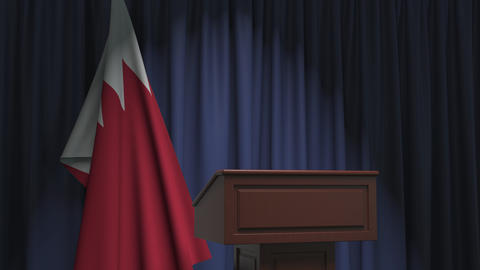 Flag of Bahrain and speaker podium tribune. Political event or statement related Live Action
