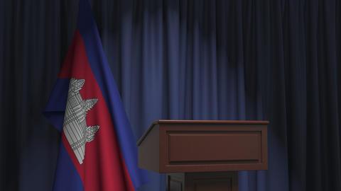 Flag of Cambodia and speaker podium tribune. Political event or statement Live Action