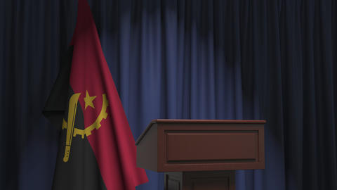 Flag of Angola and speaker podium tribune. Political event or statement related Live Action