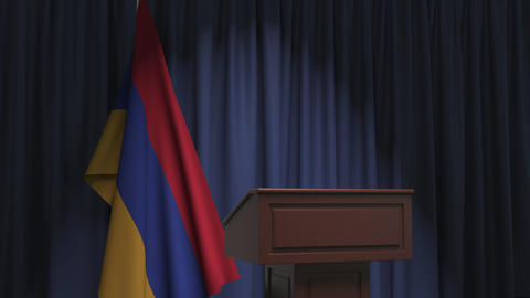 Flag of Armenia and speaker podium tribune. Political event or statement related Live Action