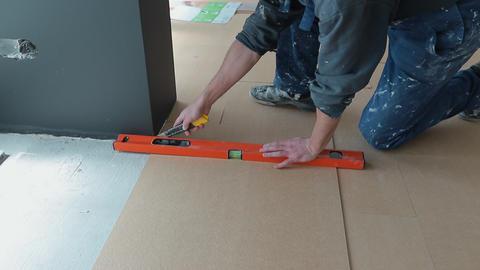 Builder renovating apartment. Repair of the apartment, laying laminate flooring GIF