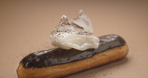 Confectioner adds cinnamon to the white chocolate on the eclair, making dessert Archivo