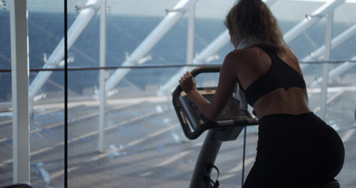 The woman at the gym on an exercise bike Archivo