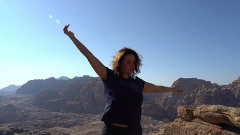 Inspirational woman enjoy life, dancing outdoors at the edge of mountains Archivo